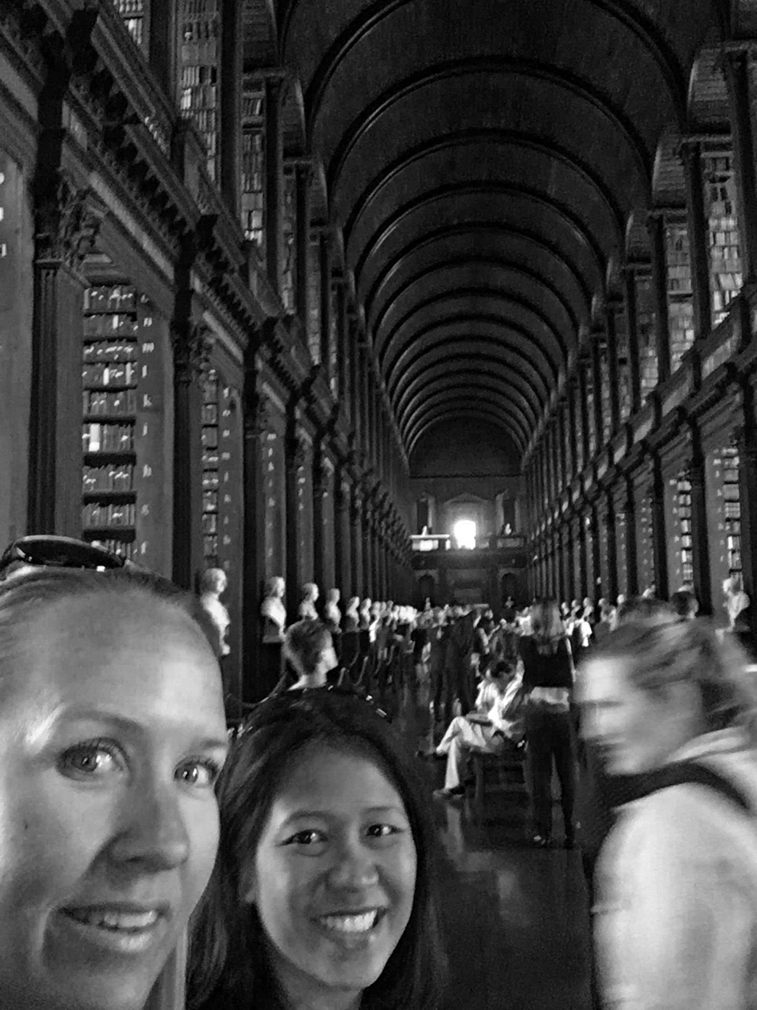 Mrs. Alt and her best friend in the long library at Trinity college